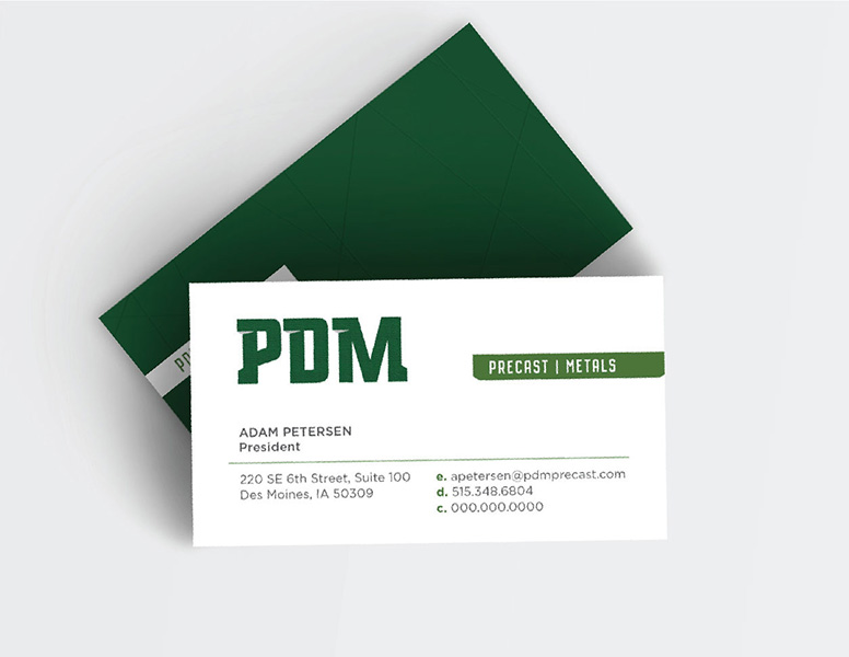 Green and white business card designed for PDM by Project7 Design