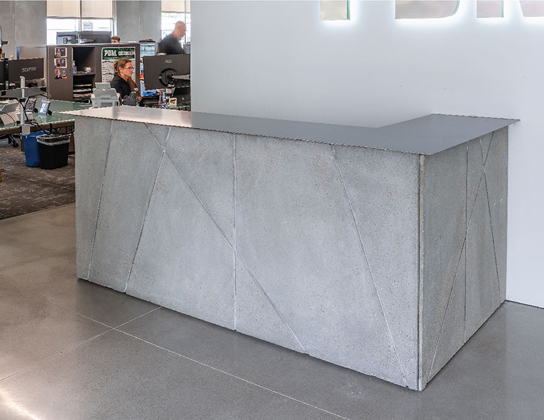 Concrete and metal front desk at the offices of PDM in Des Moines, Iowa