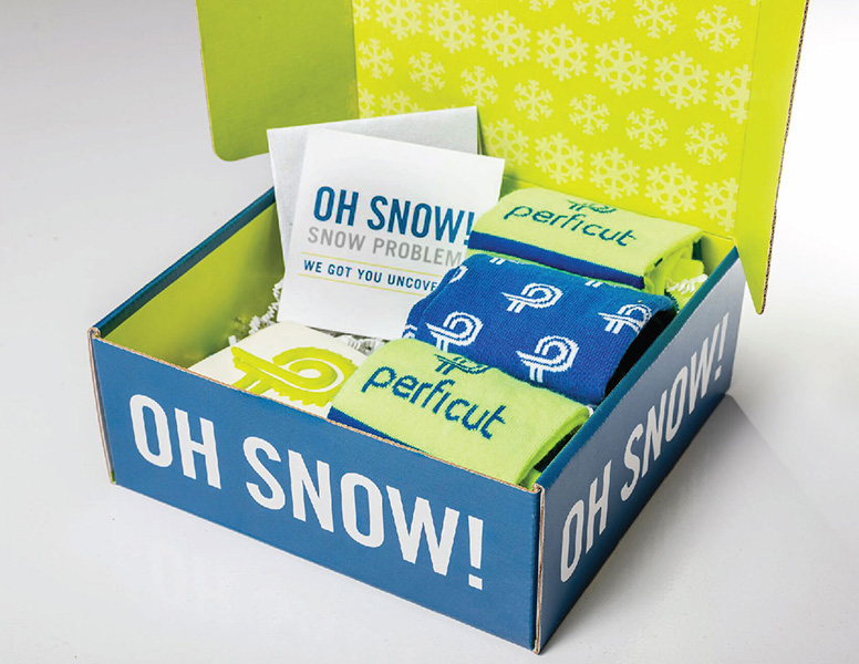 Oh Snow box of Perficut swag included branded socks created by Project7 Design