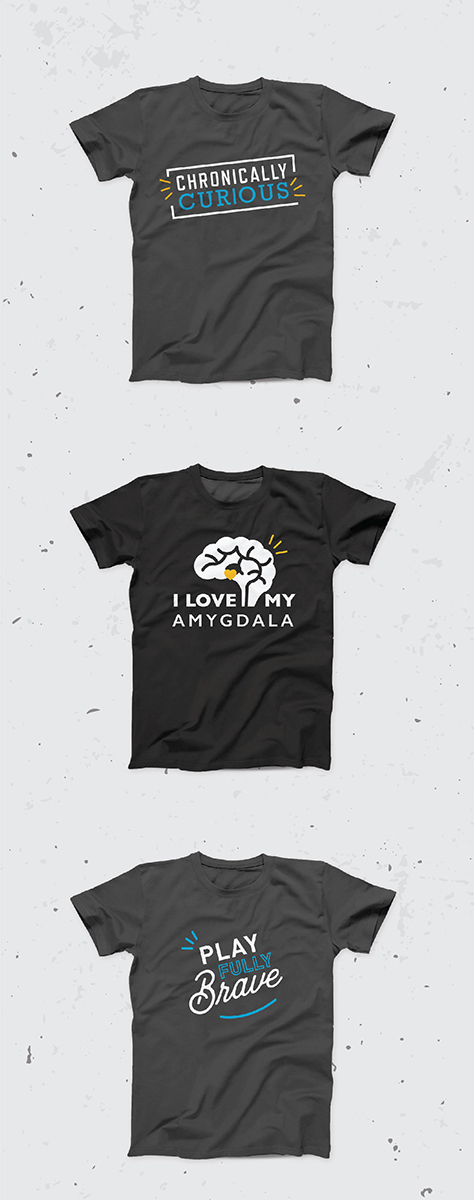 "Three branded Sarah Noll Wilson T-shirts reading ""Chronically Curious,"" ""I Love My Amygdala"" and ""Play Fully Brave"""
