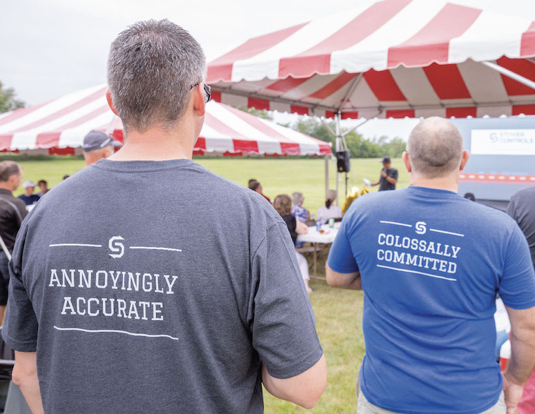 Stover Controls T-shirts on two people