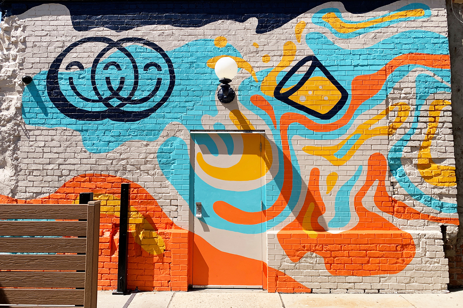 Image of completed blue, yellow and orange mural at Chummy in Des Moines, Iowa