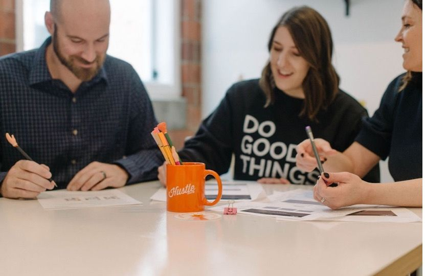 Three people sitting at a table collaborating